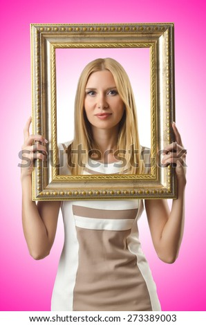 Picture frame and attractive woman - stock photo