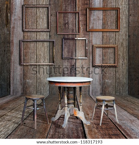 Picture frame and furniture in vintage wood room. - stock photo