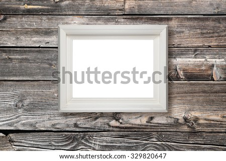 Picture frame hanging on wooden wall - stock photo