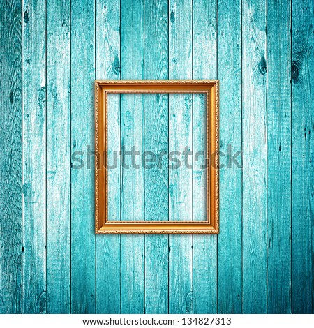 Picture frame on blue wood background - stock photo
