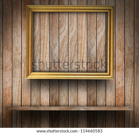 Picture frame on wood wall, With wood shelf design - stock photo