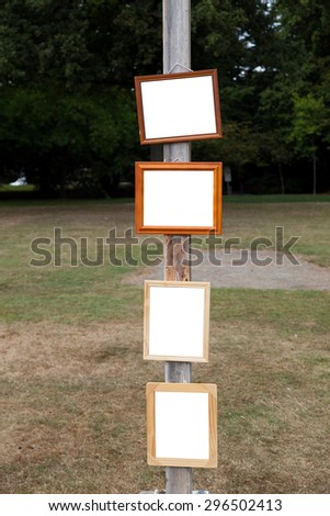 Picture Frame on wooden pole close up - stock photo