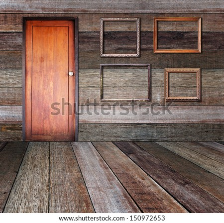 Picture frame put on wall in wood room. - stock photo