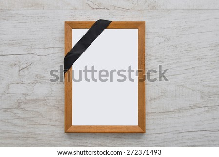 Picture frame with mourning band - stock photo