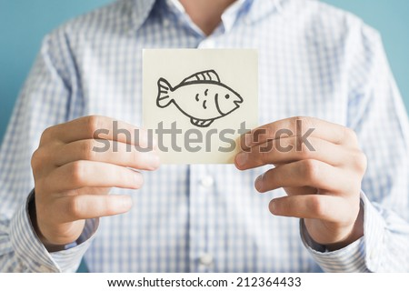 Picture icon in the hand fish - stock photo