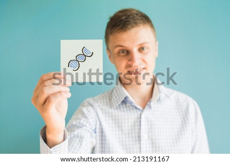 Picture icon in the hand Image of DNA strand - stock photo