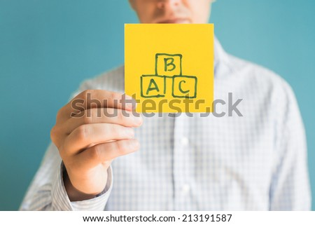 Picture icon letters ABC in hand - stock photo