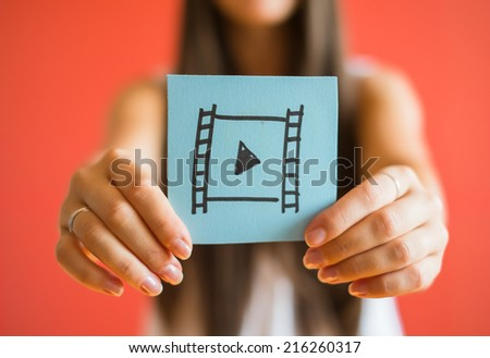 Picture icon to reproduce in his hand - stock photo