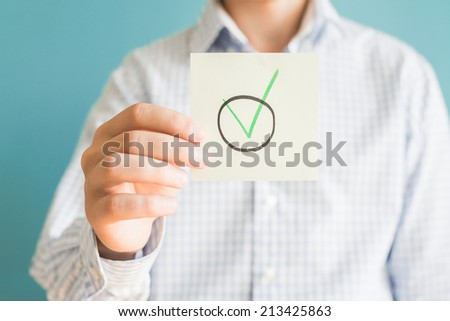 Picture icon yes in hand - stock photo