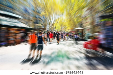 picture in zoom effect of people in the shopping street of the city  - stock photo