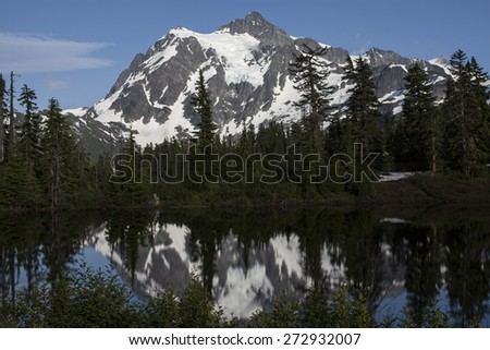 Picture Lake Reflection of Mt Shuksan in the Cascade Wilderness  - stock photo
