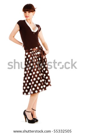 Picture of a beautiful alluring young girl in spotted skirt on white background - stock photo