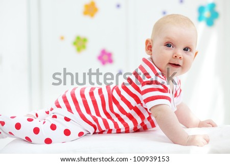 Picture of a beautiful baby at home - stock photo