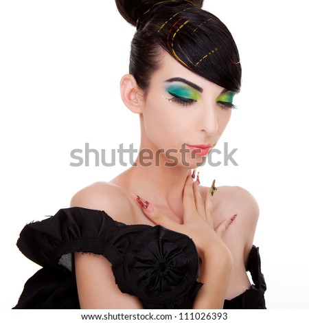 Picture of a brunette young woman model in a black dress looking down. over white background - stock photo