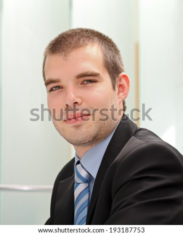 Picture of a confident businessman sitting in his office - stock photo