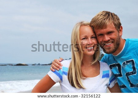 Picture of a cute young couple at the beach in california. - stock photo