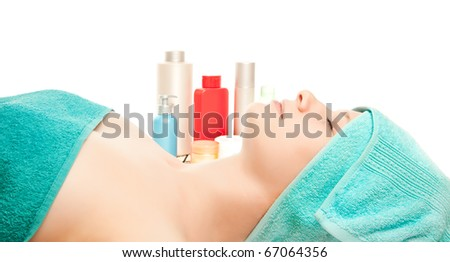 Picture of a girl at spa procedures isolated on white - stock photo