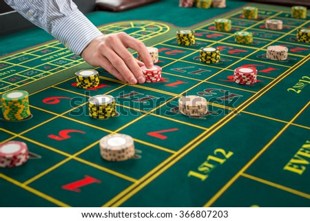 Picture of a green table and betting with chips.  - stock photo