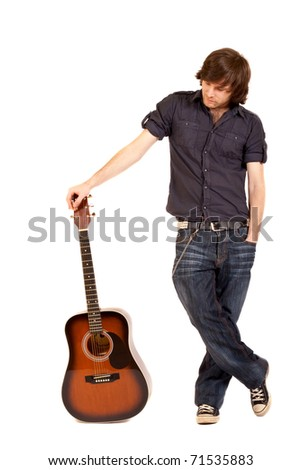 picture of a guitarist with acoustic guitar over white - stock photo