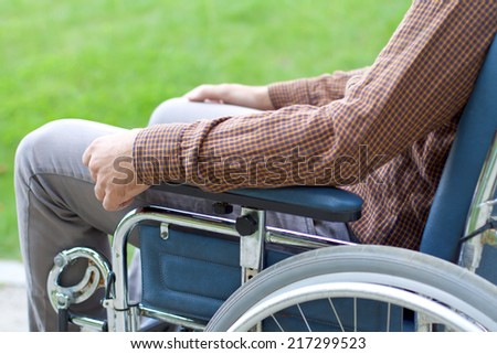 Picture of a handicap businessman with his wheelchair - stock photo