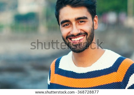 Picture of a handsome smiling man mixed race looking at camera - stock photo
