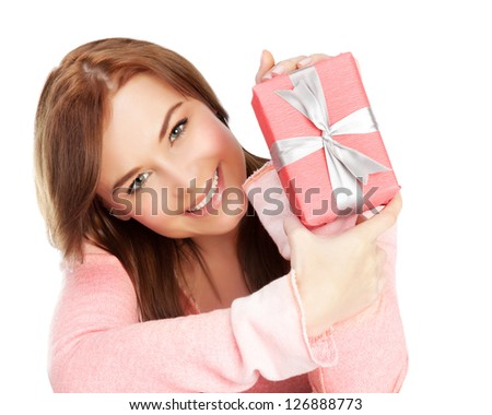 Picture of a happy young adult girl with gift box, cheerful female isolated on white background, pretty woman portrait with romantic present, holiday celebrations concept - stock photo
