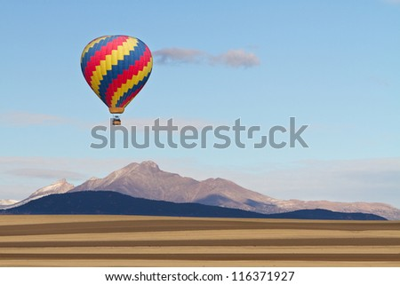 Picture of a Hot Air Balloon over the Colorado Rocky Mountains Twin Peaks, Mt Meeker and Longs Peak, Boulder County. - stock photo