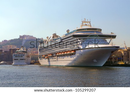 Picture of a huge ship, departing on a cruise at sunset on a summer day, Italy. - stock photo