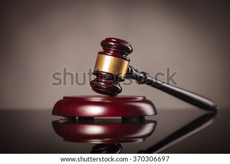 picture of a judge gavel on grey studio background - stock photo
