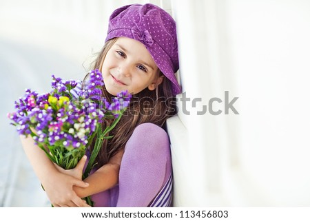 Picture of a little girl with flowers in their hands - stock photo