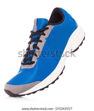 Picture of a pair of blue trainers over a white background - stock photo
