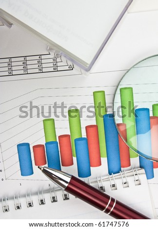 Picture of a pen and smartphone on a stock chart - stock photo