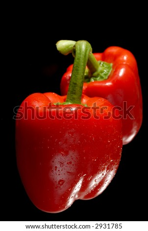 Picture of a pepper on a black background - stock photo