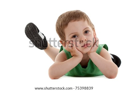 picture of a sad little boy lying on a white background - stock photo