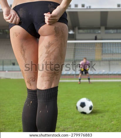 Picture of a sexy woman before a penalty kick. Goalkeeper in background. - stock photo