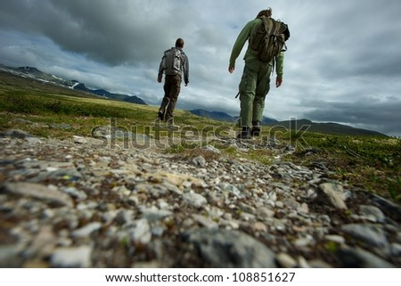 PIcture of a two hikers walking - stock photo