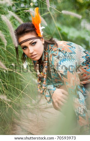 Picture of a woman posing in the forest - stock photo