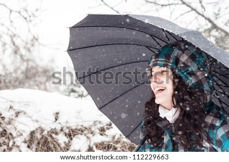 Picture of a woman with a lot of snowflakes - stock photo