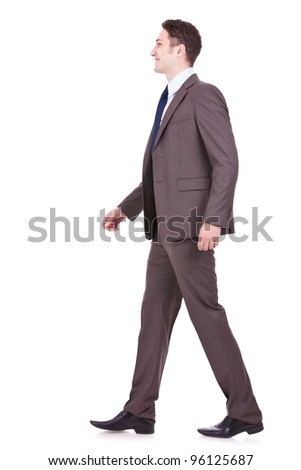 picture of a young business man walking forward on white background. side view of a young businessman walking - stock photo