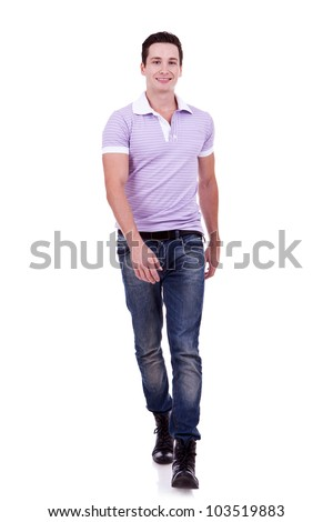 picture of a young fashion man pointing to the camera on white background - stock photo