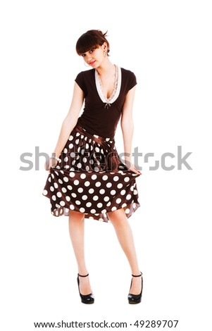 Picture of a young modest beautiful girl in blouse and spotted skirt. Isolate on white. - stock photo