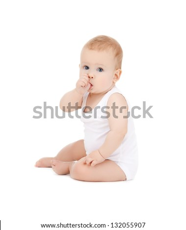 picture of adorable baby with finger in mouth - stock photo