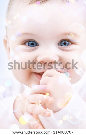 picture of adorable baby with soap bubbles - stock photo