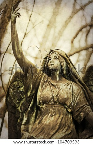 picture of an angel statue in vintage colors - stock photo