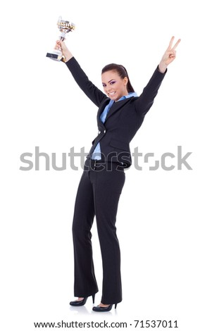 picture of an attractive business woman winning a gold trophy - stock photo