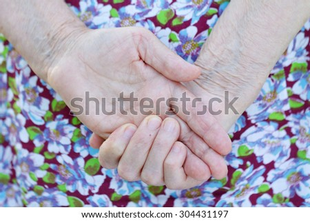 Picture of an elderly wrinkled woman hand - stock photo
