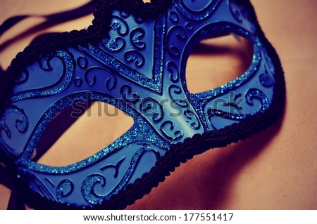 picture of an elegant blue and black carnival mask with a retro effect - stock photo