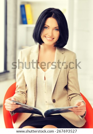 picture of attractive businesswoman with magazine. - stock photo