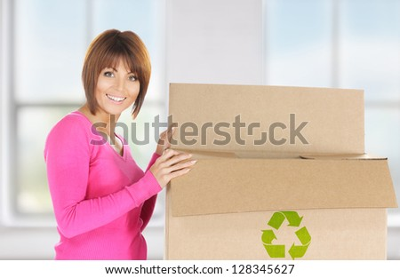 picture of attractive businesswoman with recyclable box - stock photo
