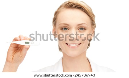 picture of attractive female doctor with thermometer - stock photo